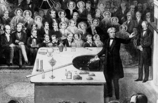 Faraday giving a Christmas lecture in 1856, via Wikipedia.