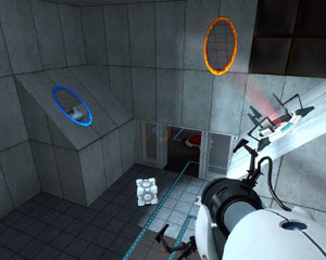 "The Portal Gun, a pair of portals and the ""companion cube."" Via Wikipedia."
