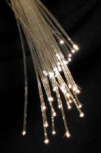 The end of a bundle of fiber optic cables, showing the light emerging.  Via Wikipedia.