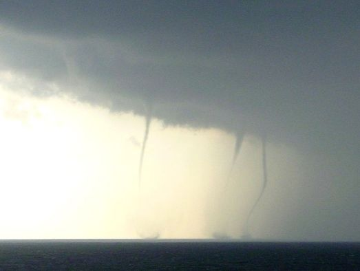 Waterspouts on the beach of Kijkduin near The Hague, the Netherlands on 2006 August 27.  Photo by Skatebiker, released into public domain & available on Wikipedia.