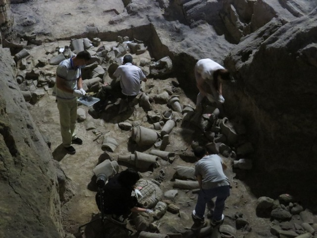 Workers uncovering new figures in Pit 2.