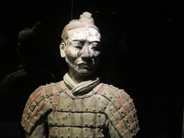 A pale-faced kneeling archer.