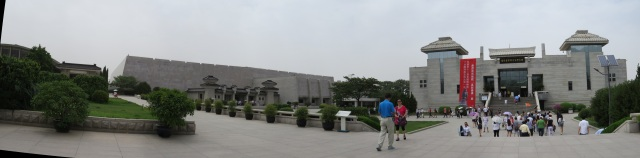Panorama of the Terracotta Army complex.  The curved building on the left houses Pit 1, the middle building houses Pit 2, and the rightmost building is a museum.  The building for Pit 3 is behind Pit 2.