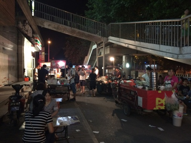 Some of the street vendors near the old NPU campus.  Note the pedestrian bridge; such bridges are often the only way to get safely across the road.