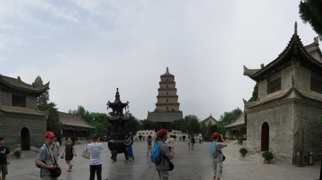 Just past the entrance to the Giant Wild Goose Pagoda complex.  Note the same fellow appearing three times in the image, thanks to panorama stitching.