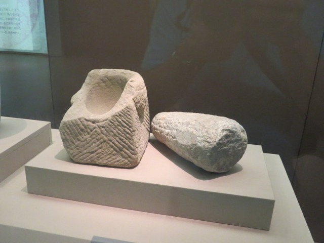 Stone mortar and pestle, excavated at the West Market.