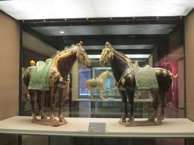 Pair of tri-color pottery horses.