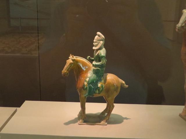 Tri-color Hu tribesmen rider.