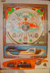 A Pachinko machine, via Wikipedia. If this were the Sun, the balls would take thousands of years to escape through the bottom.