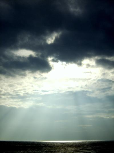 Sunlight peeking through the clouds, via Wikipedia.